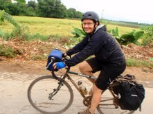 Iris riding down from a mountain town called Kalaw.  She had descended 4500 feet in the pouring rain on a pretty bad road, but she's still smiling.
