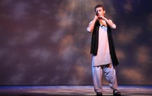 Hisam Baig performs a Hindi-Urdu song during the International Night talent show at Edmonds Community College.